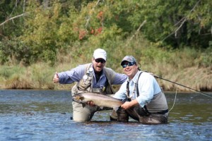 Jay Fargher and guide Andre Anthony from the Ledges in Doaktown, NB on the Main Southwest Miramichi River with a nice MSW salmon