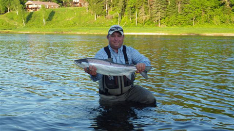 Derek Munn sends this photo of a salmon he hooked Monday evening on a #6 Shady Lady bug. It fought unreal, was jumping a lot and went into his backing three times.