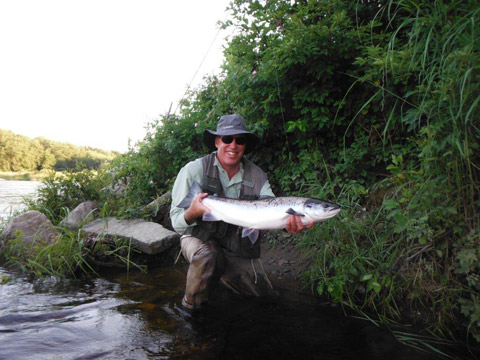 This is David Rance from the UK with a nice hen salmon taken on #6 Cascade