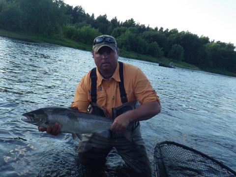 Guide Derek Munn with a 16lb hen caught by veteran fishermen Dr. Scott Boley on #6 Smurf