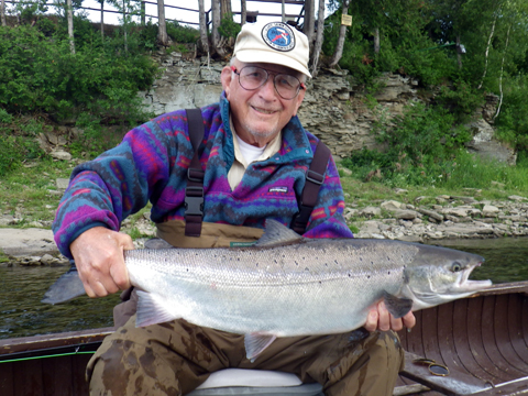 Dr. Scott Boley with one of many salmon he caught on a #6 Smurf in the last week.