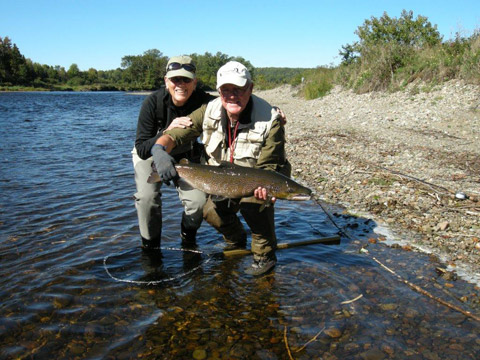 Here is guide Ralph Goodwin with veteran angler Andrea Warner and a nice hook bill salmon.