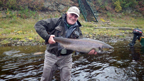 This is a picture of Bill Haldane with a 24lb salmon taken at Flo's pool on and African Mistake.