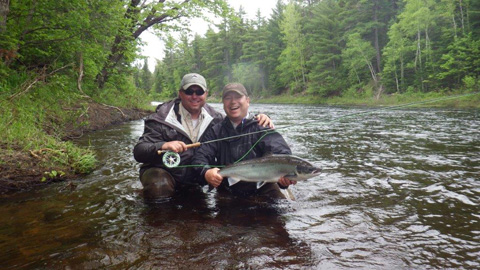 Derek Munn and Andrew with a nice salmon on a tributary of the main Souwest Miramichi