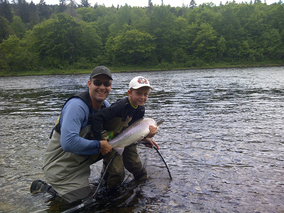 From Mark Coy, Fredericton: My 7 year old landed his first salmon on Thursday last week. Hooked in the Boiestown area.
