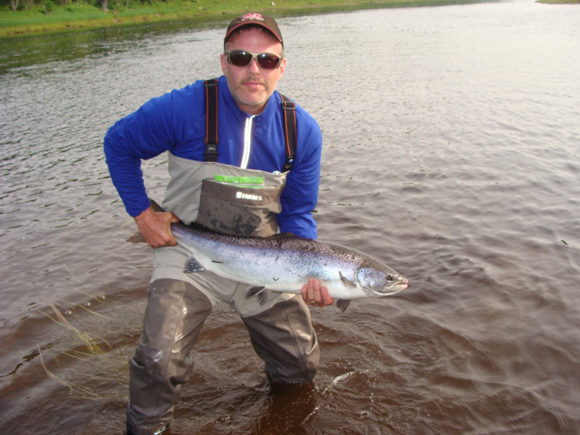 From Kevin Pugh: Here is a pic of Salmon I caught at the Mouth of the Cains River Pool on the morning of Sunday June 23, 2013.  I'm guessing it was in the 25lb range.  Hooked on a Shady Lady.  It was the fifth of six Salmon caught in three days.  A lot of Salmon and very few grilse.