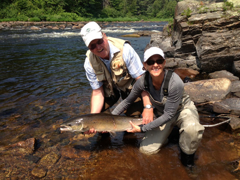 Ledges guest Anne Talbot-Kleeman with a beautiful salmon taken on a white and orange bomber. Tight lines!