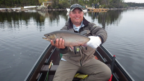 Derek Munn with a trout from Igloo Lake Lodge in Labrador. Awesome trip!