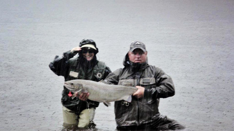 Barbara McGuire with her fourth fish of the (rainy!) day - a 27 lb hen taken on a shady lady