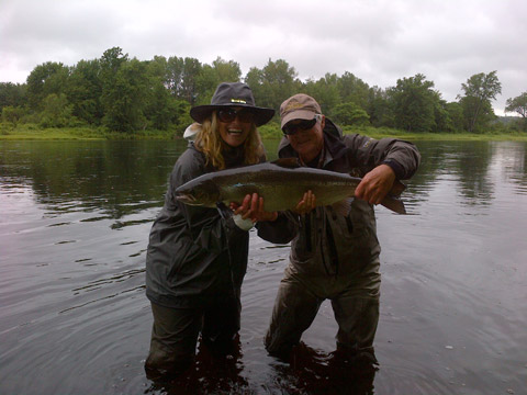Sharon Needham and guide Lloyd Lyons with her first Atlantic salmon.