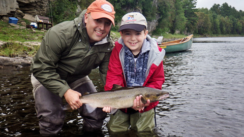 Joe and Aiden Palmer with a nice salmon taken on a White-Tailed Green Machine.